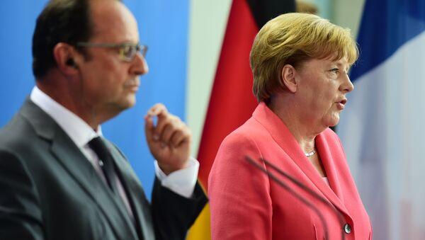 Kancléřka SRN Angela Merkelová a prezident Francie Francois Hollande - Sputnik Česká republika