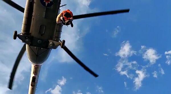Evakuace obětí z oblasti povodní v Irkutské oblasti. - Sputnik Česká republika