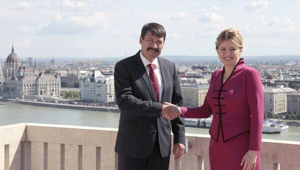 Maďarský prezident János Áder a prezidentka Slovenska Zuzana Čaputová 11.července 2019 v Budapešti - Sputnik Česká republika