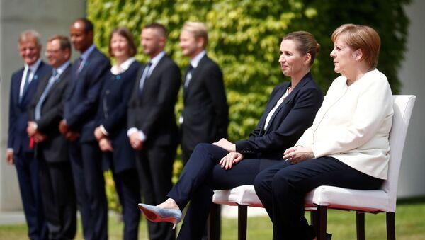 Angela Merkelová a dánská premiérka Mette Frederiksenová  - Sputnik Česká republika