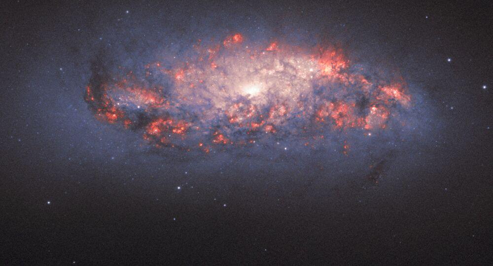 Galaxie NGC 972. Ilustrační foto