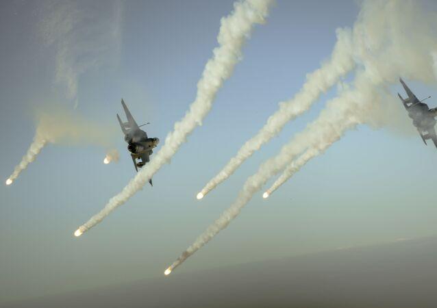Letadla koalice F-15E v průběhu operace Inherent Resolve