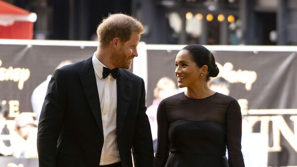 Britain's Meghan, Duchess of Sussex, and Prince Harry, Duke of Sussex, arrive for the European premiere of the film The Lion King in London, Britain July 14, 2019 - Sputnik Česká republika