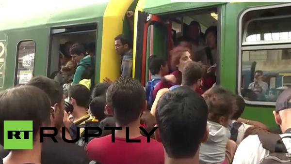 Maďarsko: Uprchlíci berou vlaky útokem - Sputnik Česká republika