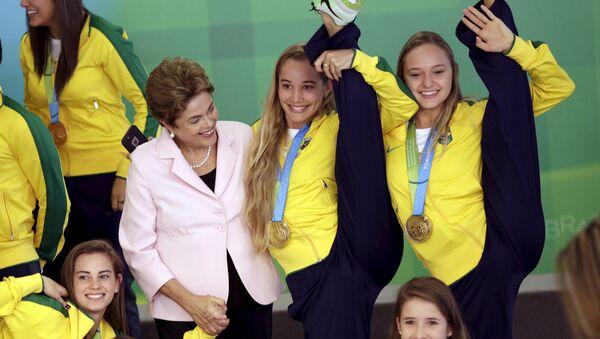 Prezidentka Brazílie Dilma Rousseffová na slavnostním přijetí delegace Panamerických her 2015 v Brazílii. - Sputnik Česká republika