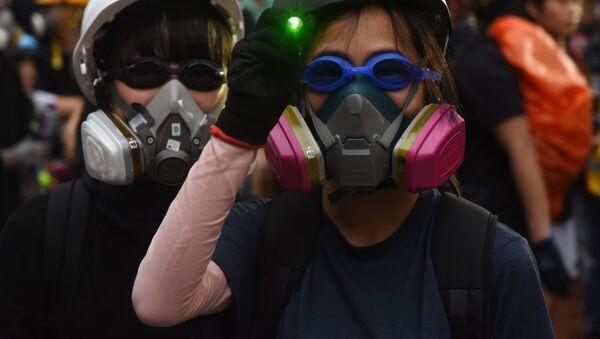 Účastníci protestů v Hongkongu - Sputnik Česká republika