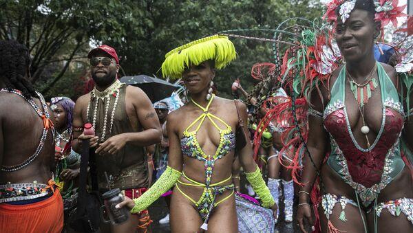 Účastníci akce West Indian American Day Parade v Brooklynu. - Sputnik Česká republika