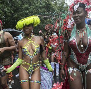 Účastníci akce West Indian American Day Parade v Brooklynu.