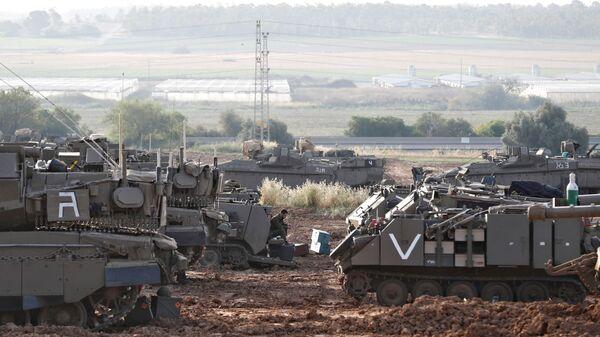 Izraelský voják na hranici s Pásmem Gazy - Sputnik Česká republika