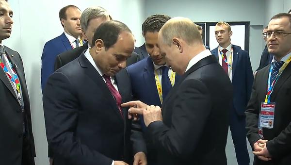 Video: Shoda? Ruský vůdce Putin a egyptský prezident as-Sísí na ekonomický summit přišli ve stejných kravatách  - Sputnik Česká republika