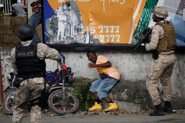 Protesty v Haiti požadují rezignaci prezidenta Jovenela Moiseho. - Sputnik Česká republika