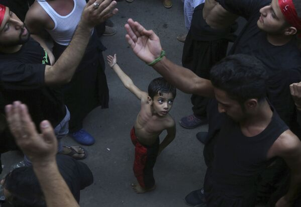 Oslavy šíitského svátku připomínající úmrtí imáma Husajna (Pakistán). - Sputnik Česká republika