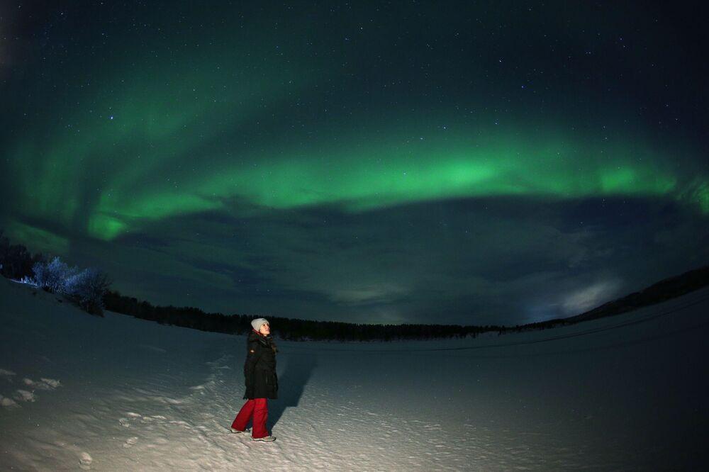 Polární záře v blízkosti řeky Ura v Murmanské oblasti.