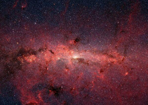 Galaktické středisko Mléčné dráhy, které vyfotil teleskop Spitzer. - Sputnik Česká republika