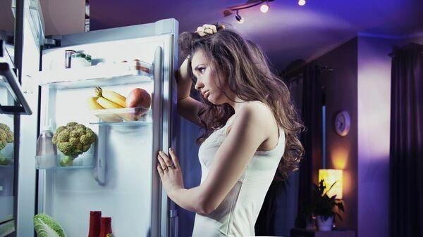 Dívka u ledničky. Ilustrační foto - Sputnik Česká republika