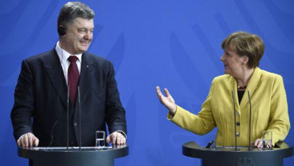 Německá kancleřka Angela Merkelová a ukrajinský prezident Petro Porošenko. Berlín, 16. března - Sputnik Česká republika