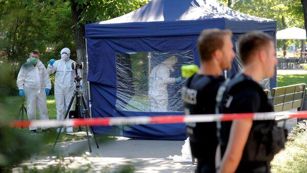 Policie na místě vraždy občana Gruzie Zelimchana Changošvili v Berlíně - Sputnik Česká republika