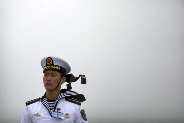Čínský námořník na palubě lodi Qi Jiguang - Sputnik Česká republika