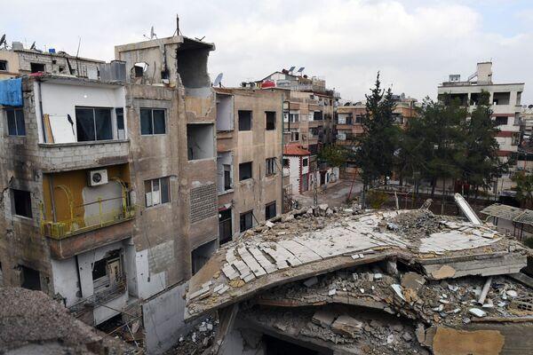Byty ve zničených budovách města Dúmá, Sýrie - Sputnik Česká republika