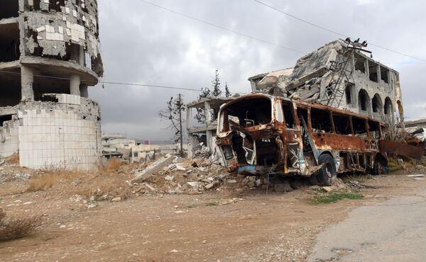 Zničené domy ve městě Dúmá - Sputnik Česká republika