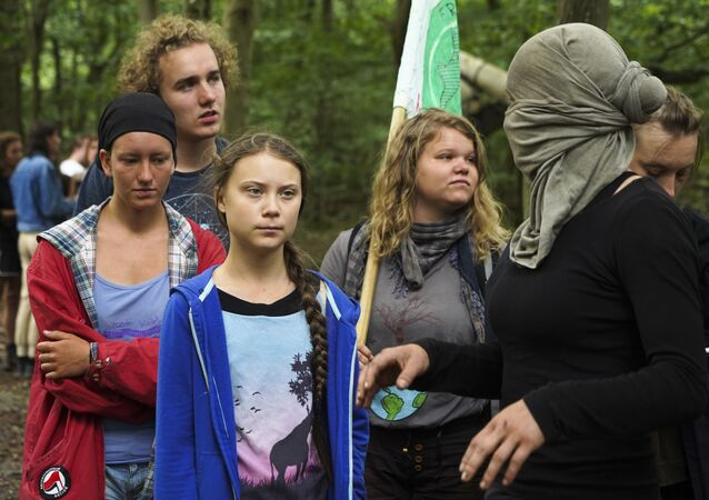 Climate activist Greta Thunberg with environmentalist protesters in the ancient Hambach Forest, Germany