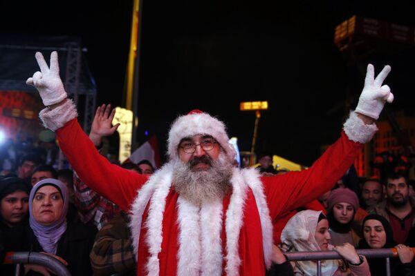 Protivládní demonstranti během oslav Nového roku v Bejrútu - Sputnik Česká republika