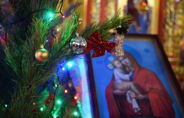 Vánoční bohoslužba v chrámu archanděla Michaela v centru Grozného - Sputnik Česká republika