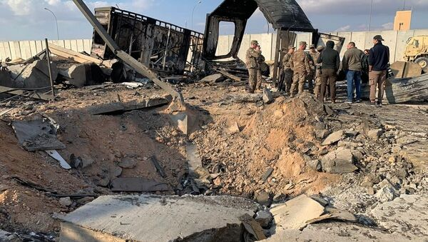Následky ostřelování letecké základny Ajn al-Asad - Sputnik Česká republika