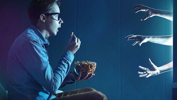 Sledování televize. Illustrační foto - Sputnik Česká republika