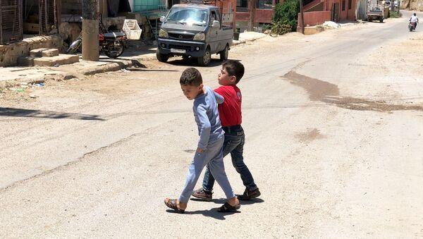 Děti v syrské vesnici Beit-Džinn - Sputnik Česká republika