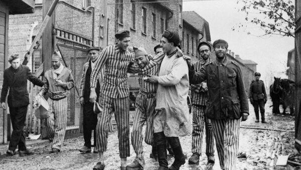 Osvobození vězňů nacistického německého koncentračního tábora Auschwitz-Birkenau sovětskými jednotkami - Osvětim, Polsko - Sputnik Česká republika