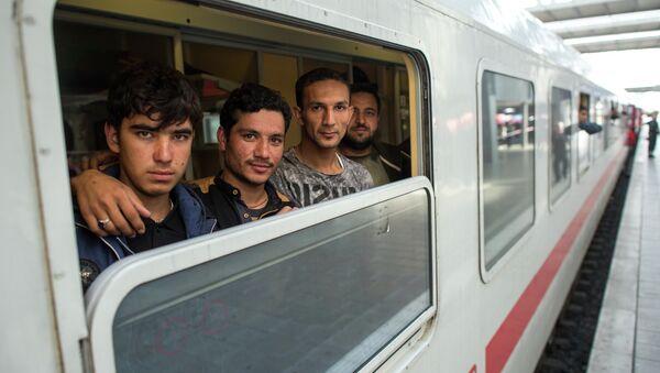 Uprchlíci ve vlaku v Mnichově - Sputnik Česká republika