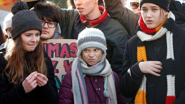 Švédská aktivistka pro změnu klimatu Greta Thunbergová se účastní protestu na 50. výročním zasedání Světového ekonomického fóra (WEF) v Davosu - Sputnik Česká republika