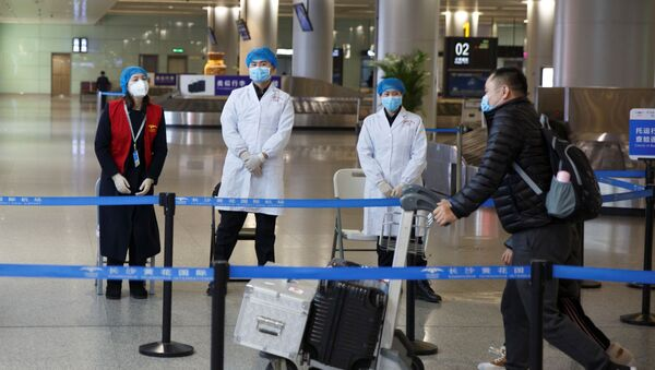 Lékařský monitoring na letišti v Číně - Sputnik Česká republika
