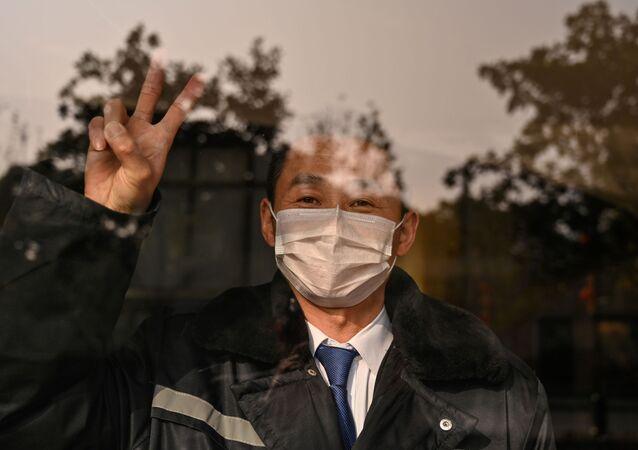 Muž v hotelu. Wu-chan, Čína