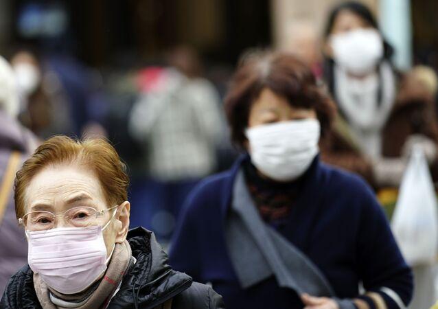 Strach z koronaviru: Číňané nosí ochranné masky kvůli riziku infekce