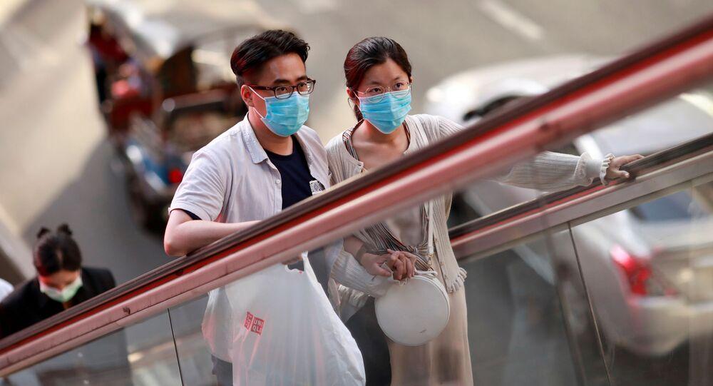 Obyvatelé Bangkoku v ochranných maskách