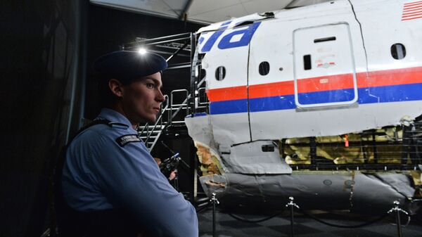 Представление доклада об обстоятельствах крушения лайнера Boeing 777 Malaysia Airlines на Востоке Украины  - Sputnik Česká republika