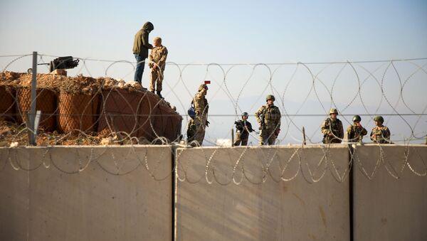 Turečtí vojáci na hranici se Sýrií v provincii Idlib - Sputnik Česká republika