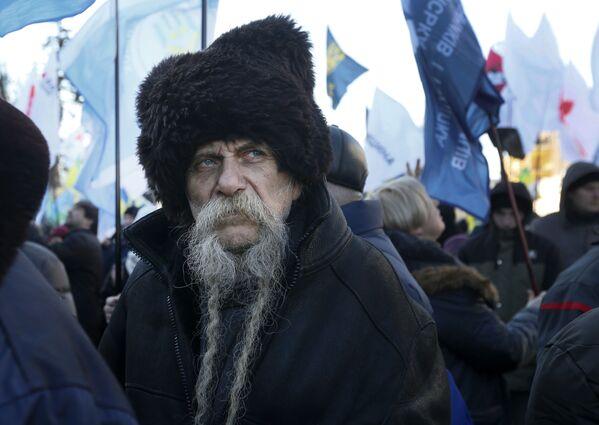 Účastník protestů proti legislativě o prodeji zemědělské půdy, 6 února 2020. Kyjev, Ukrajina - Sputnik Česká republika