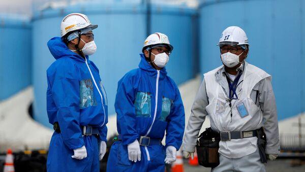 Pracovníci na atomové elektrárně Fukušima 1 - Sputnik Česká republika