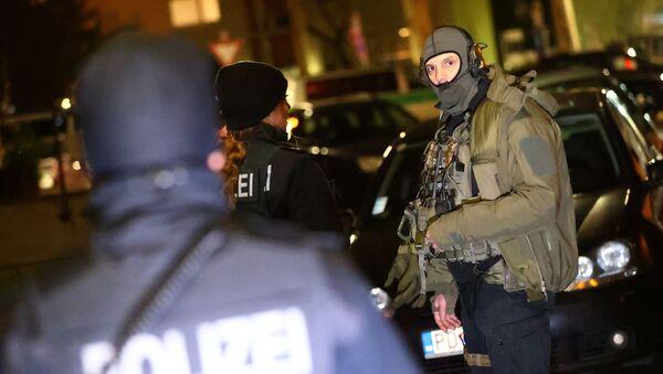 Němečtí policisté v Hanau po útoku neznámého pachatele. Zemřelo devět osob - Sputnik Česká republika