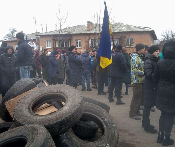 Místní obyvatelé protestují proti umístění krajanů evakuovaných z Wu-Chanu v místní nemocnici. - Sputnik Česká republika