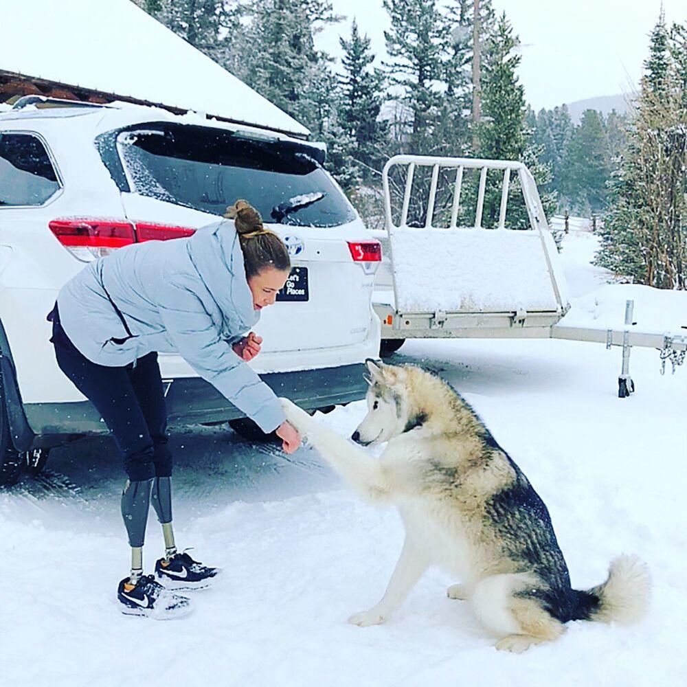 Sportovkyně Oksana Masters se psem