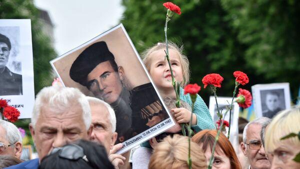 Účastníci akce Nesmrtelný pluk v Kyjevě - Sputnik Česká republika
