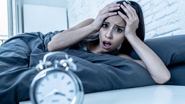 Dívka trpí nespavostí. Ilustrační foto - Sputnik Česká republika