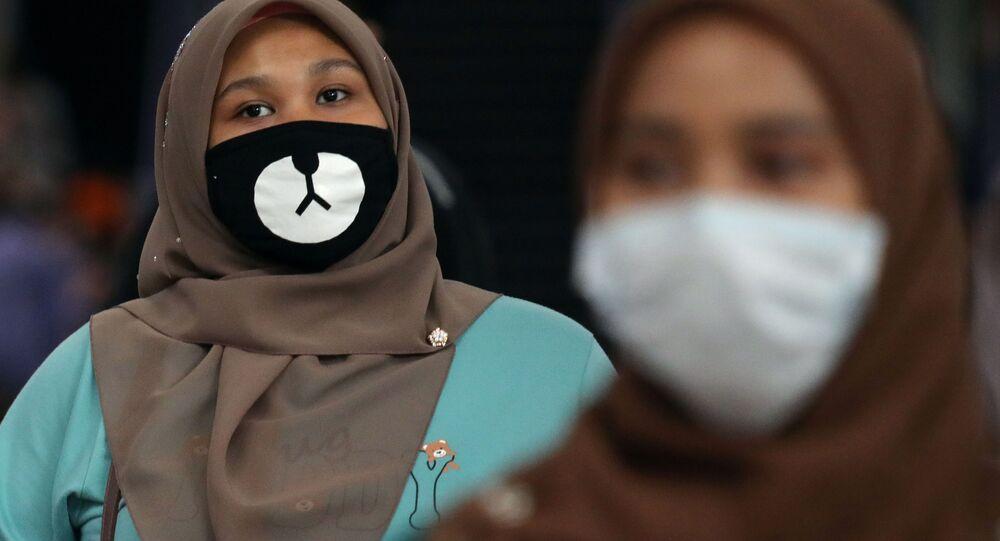 Maskovaný cestující v Malajsii
