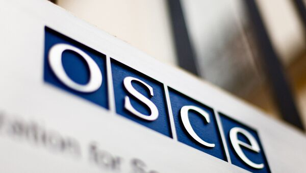 Logo OBSE - Sputnik Česká republika