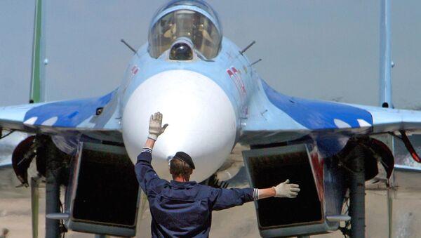 Ruská stíhačka Su-27 v Bělorusku - Sputnik Česká republika