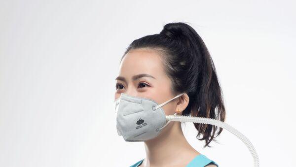 Čínští vědci vyvíjejí elektrostatické antivirové roušky - Sputnik Česká republika